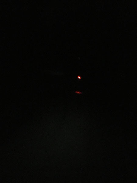 a taillight barely visible in the dark