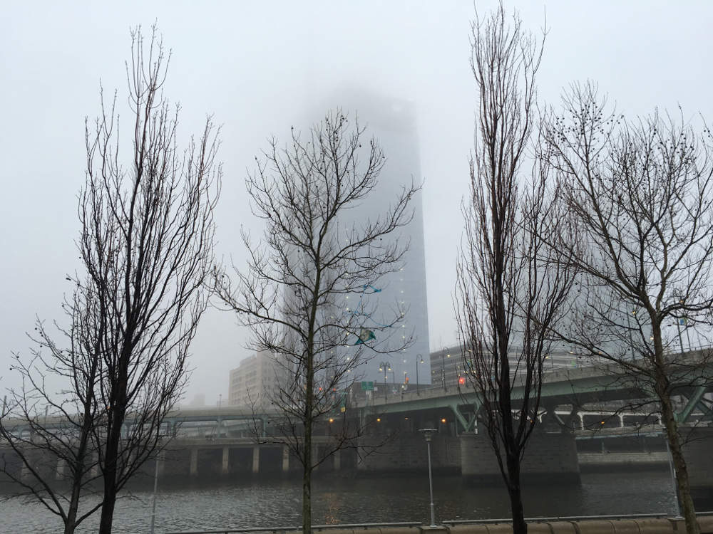 the comcast building behind fog