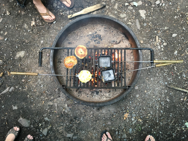 a bagel and eggs cooking over a fire